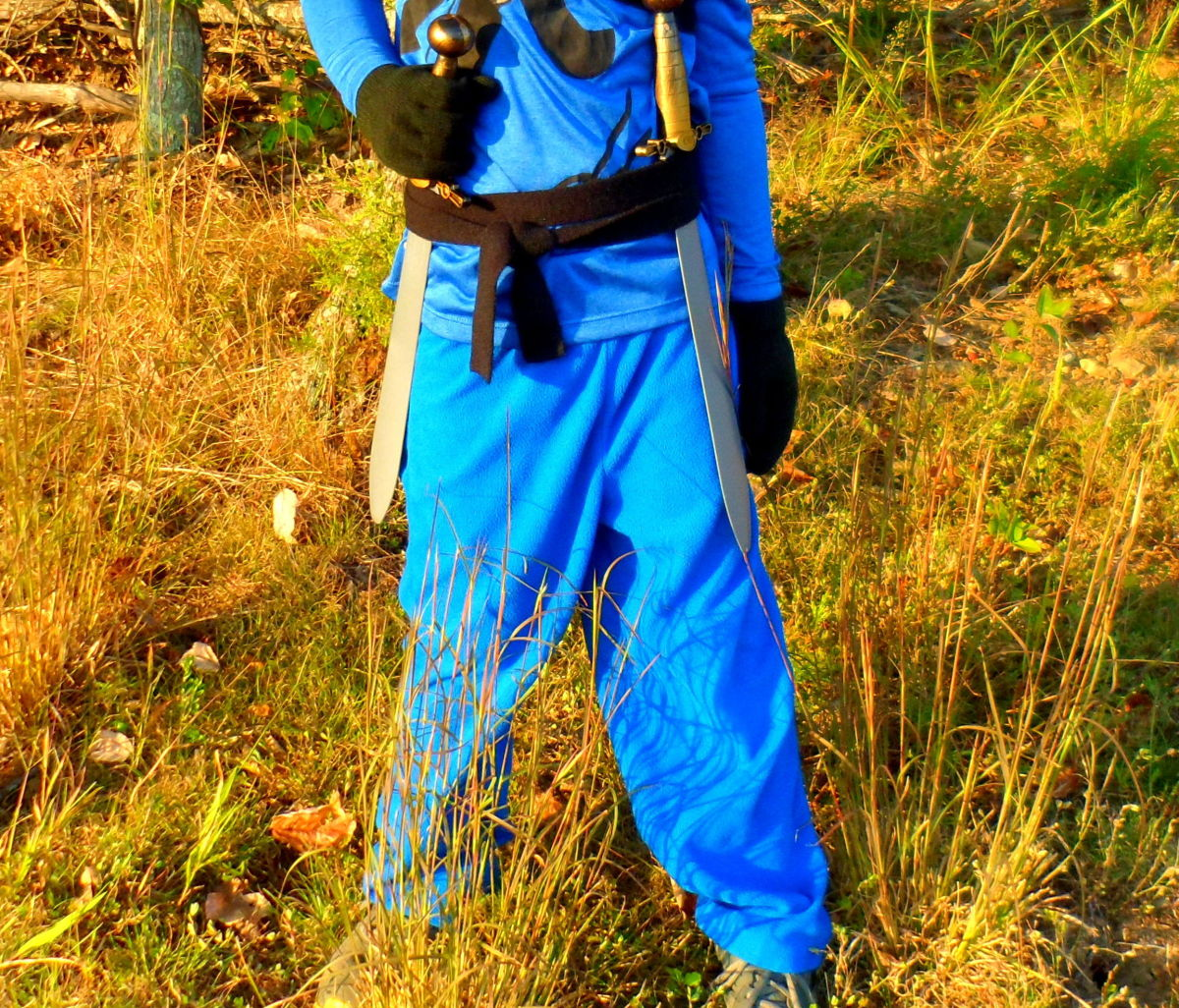 Blue pants, black belt and gloves, and a weapon of your choice completes this costume.