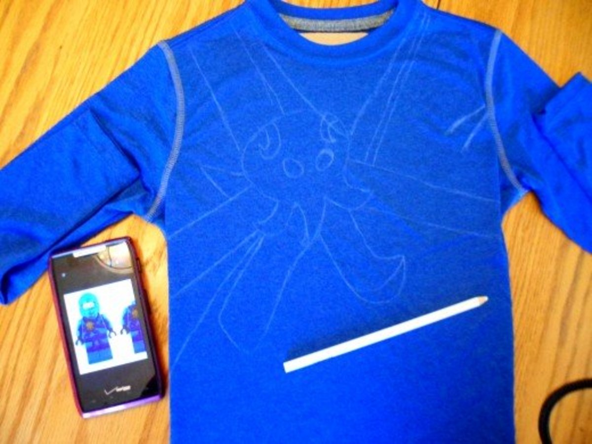 Use a white colored pencil to make the design on the shirt.