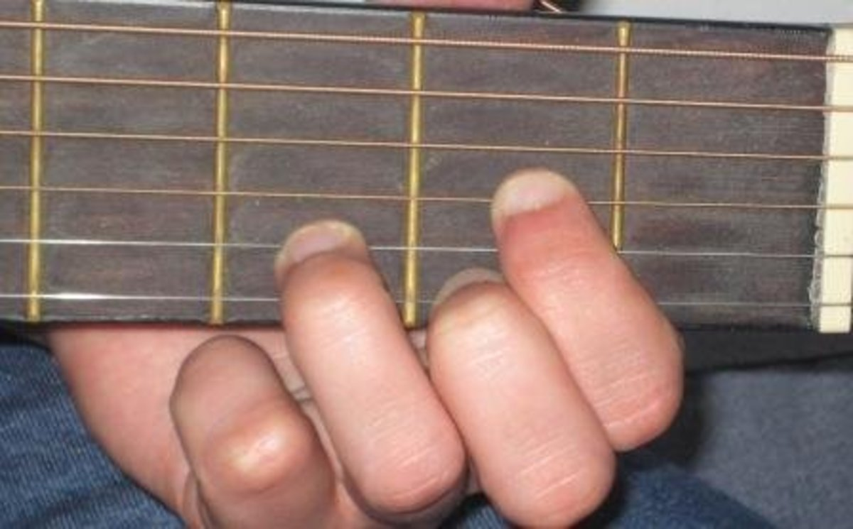 Me demonstrating the D chord on guitar.