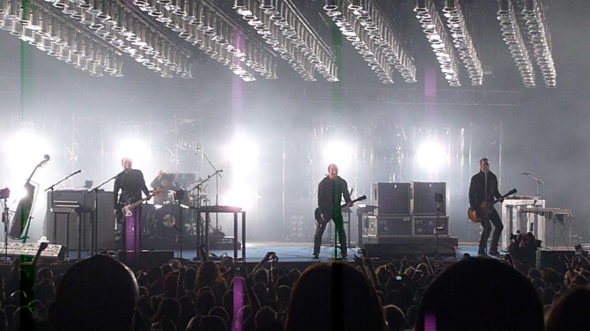 Nine Inch Nails on stage in 2009.  It was the industrial band who first recorded the song in 1995 and later publicly performed it.  The song, written by Trent Reznor, references self-harm and heroin addiction.