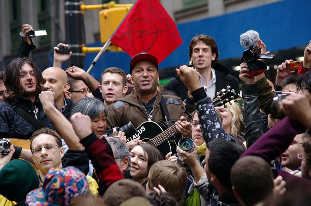 "Tom Morello of Rage Against the Machine playing Occupy Wall Street. Tom Morello has also performed a reworked version of ""The Ghost of Tom Joad"" with Bruce Springsteen."
