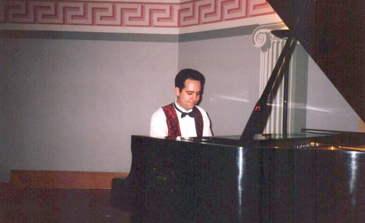 Me playing piano at the end of my college days.