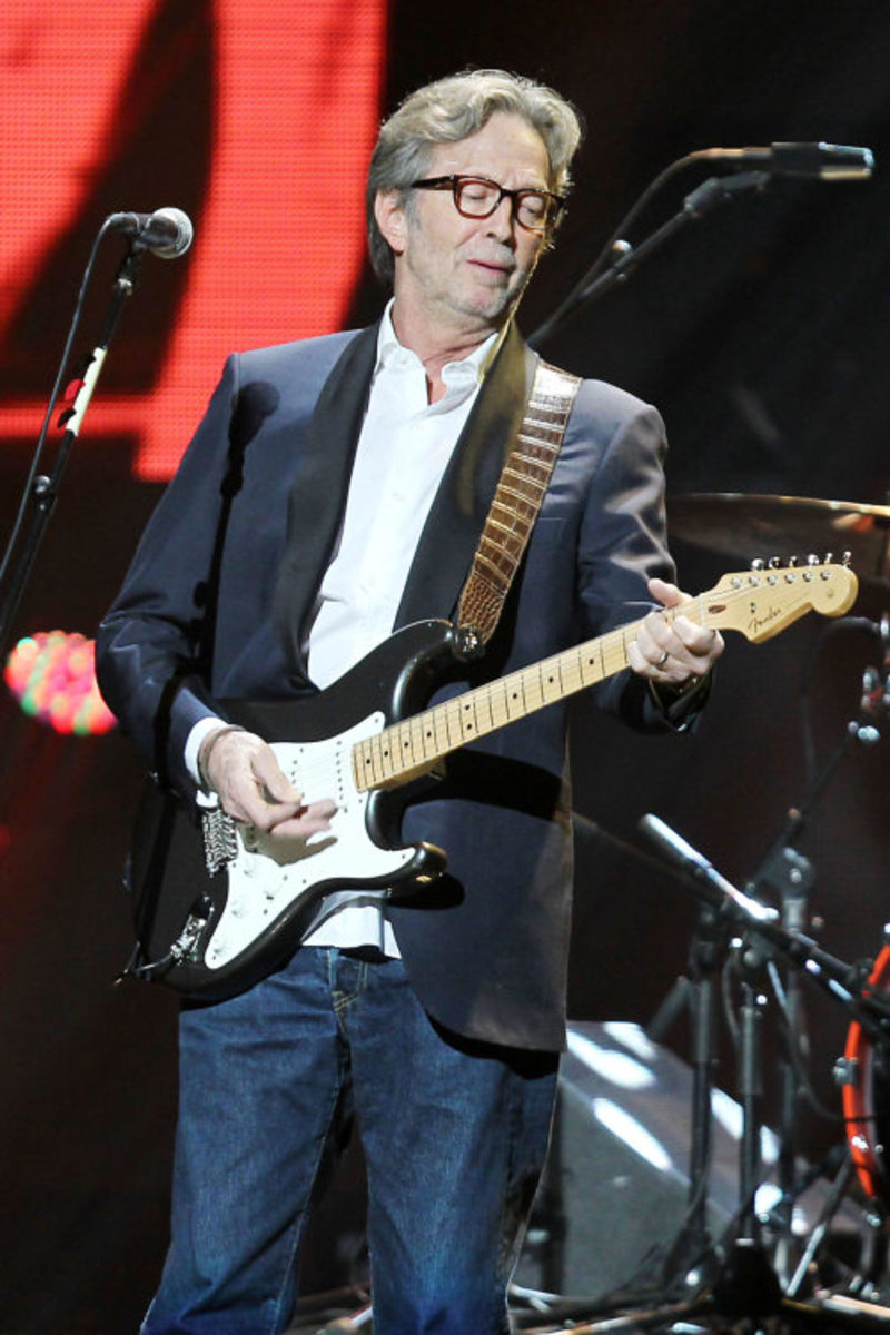 Clapton plays at the 12/12/12 concert