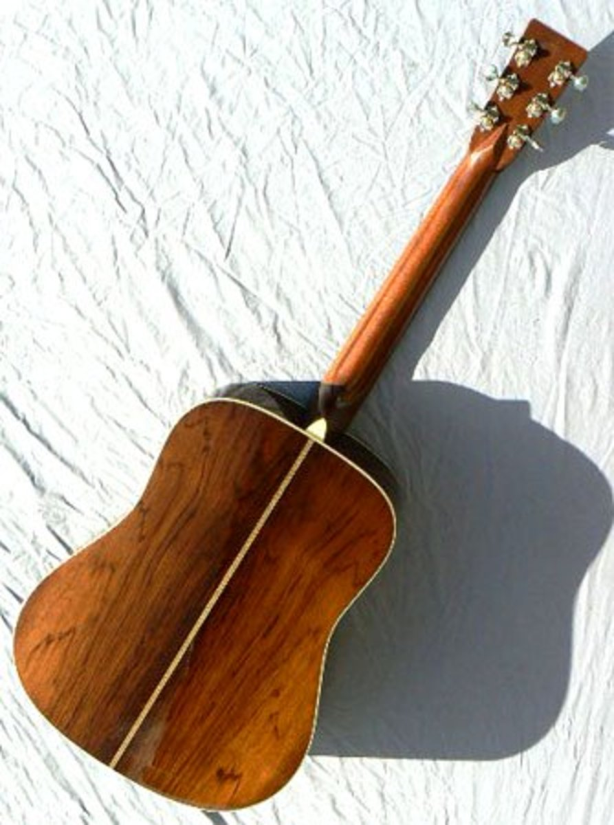 Same source, same individual guitar, D-28GE rear view.
