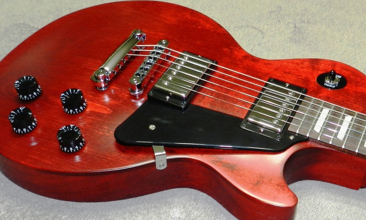 GIbson Les Pauls typically feature a mahogany body with a maple cap.