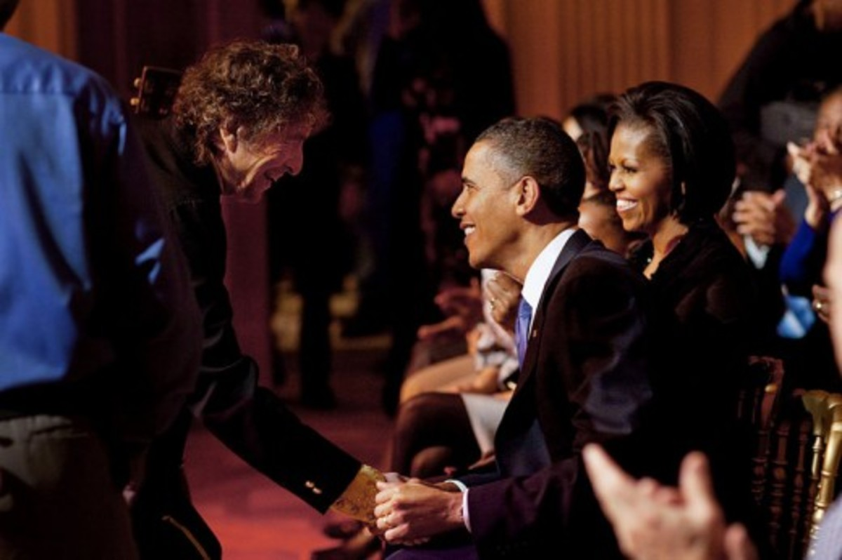 "Bob Dylan shakes the hand of President Barack Obama's hand after the ""In Performance At The White House: A Celebration Of Music From The Civil Rights Movement"" concert in the East Room of the White House, Feb. 9, 2010. (Source: Public Domain Image vi"