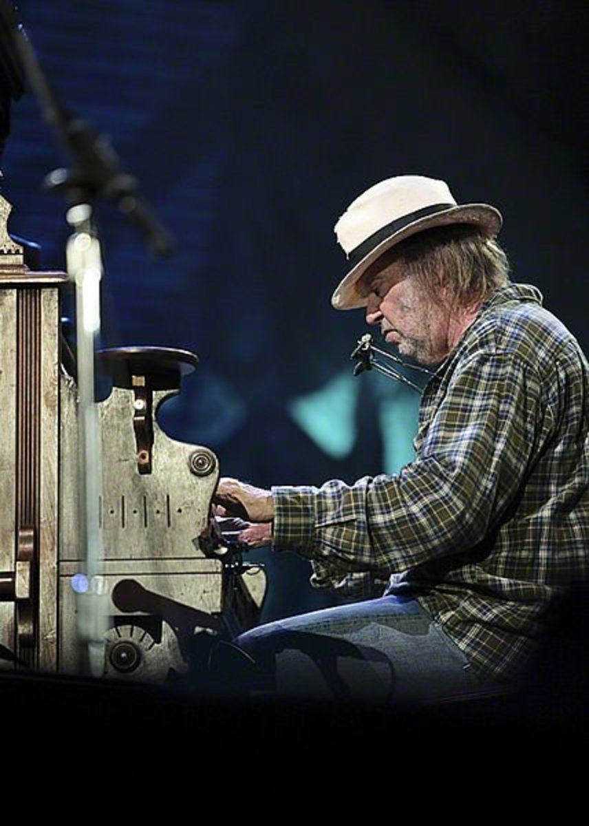 Neil Young performing at Farm Aid on October 2nd, 2010. Over the years Neil Young has quite often wrote and sang about environmental issues.