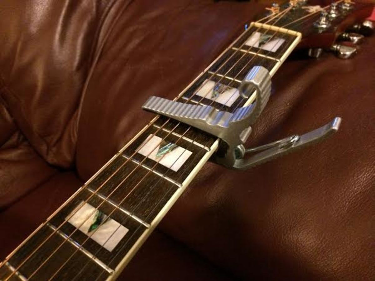A capo is a great way to make those ridiculous barred open chords easier for small handed guitarists