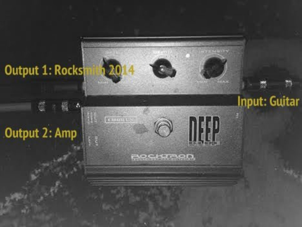I use an effects pedal with two outputs to play Rocksmith 2014 with a real guitar amp.