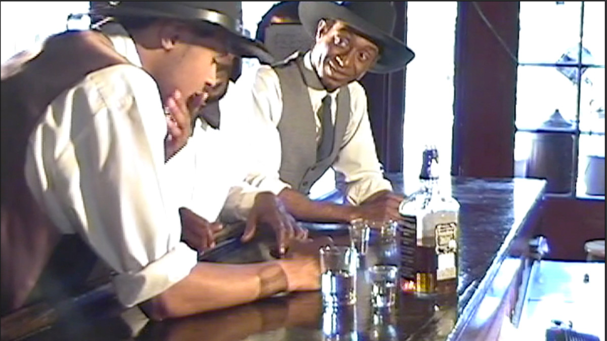 """This reenactment shows a young W.C. Handy (with hand on chin) realizing that the lyrics of his blues song """"Mr. Crump Blues"""" would not be flattering to E.H. """"Boss"""" Crump, the mayor of Memphis.  (Reenactment)"""