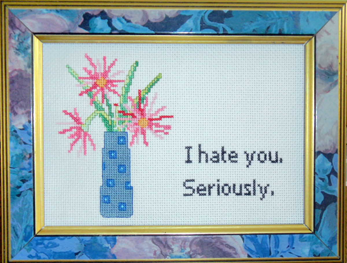"""I hate you. Seriously."" In counted cross stitch."