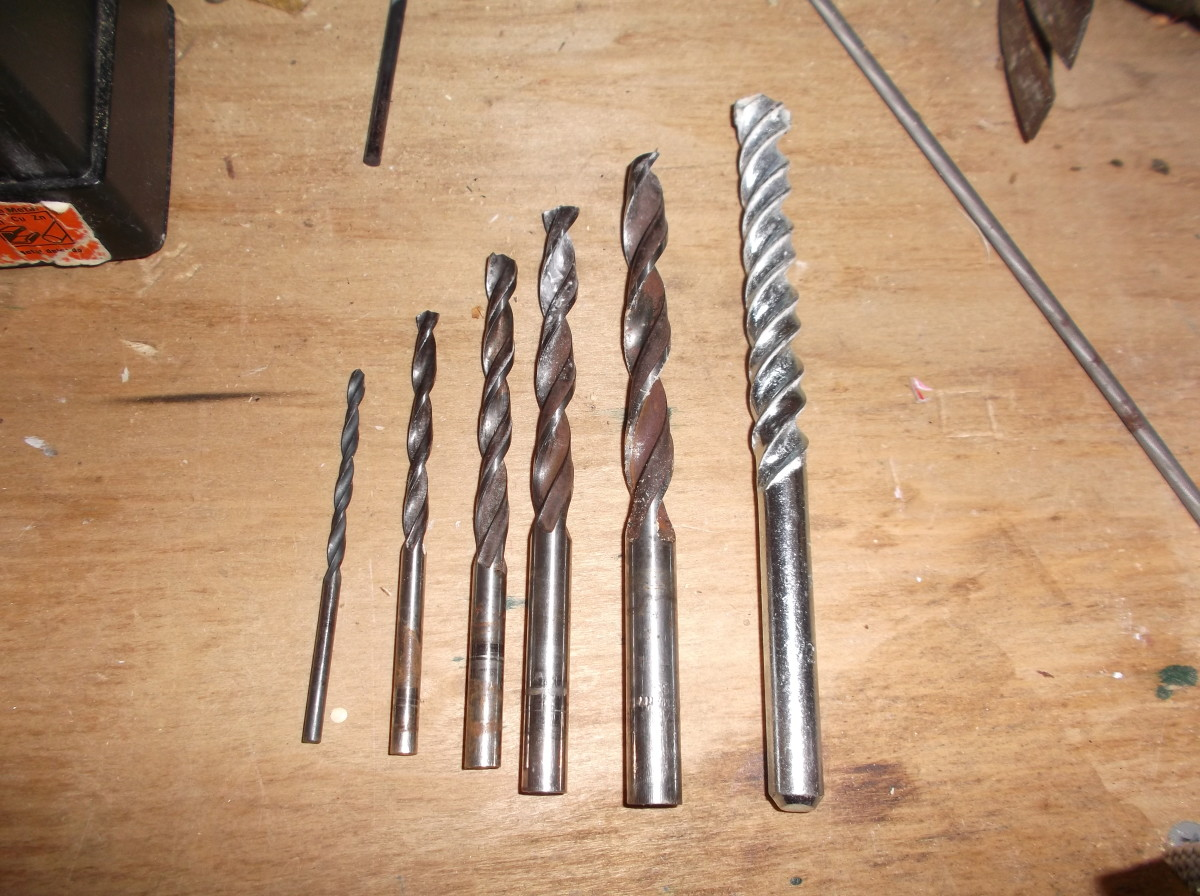 The assortment of drill bits used for the endpin jack hole.