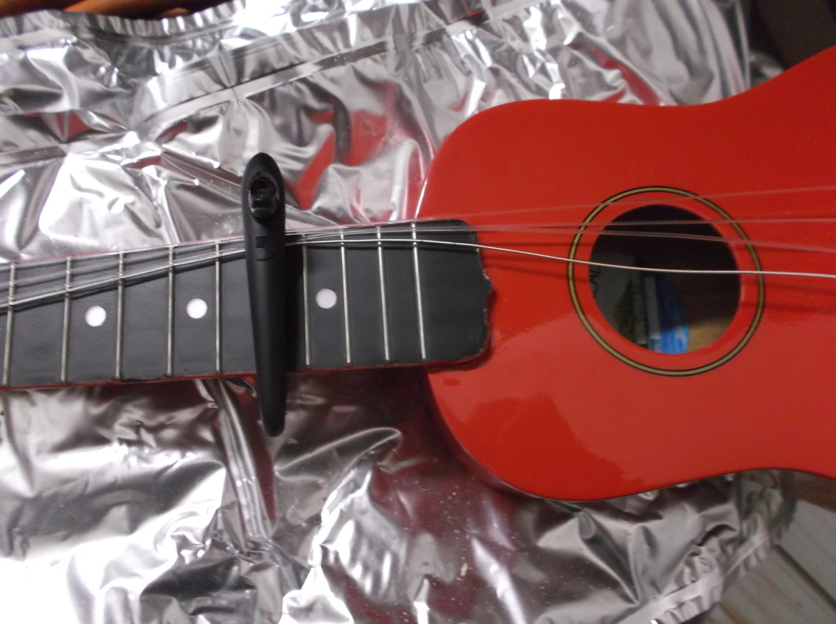 Loosen strings and secure away from sound hole.