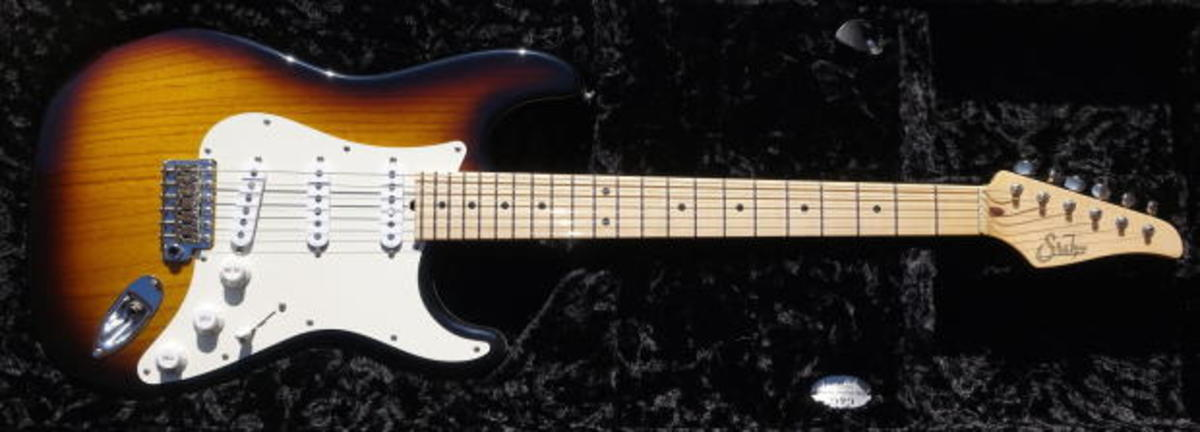 "A beautiful Suhr Custom Classic S (not Pro Series) Stratocaster in two tone vintage finish with lightweight swamp ash body weighing on 7.3lbs! The neck is a nice maple with 9""-12"" compound radius and soft V profile. The pickups are '54s and give the"