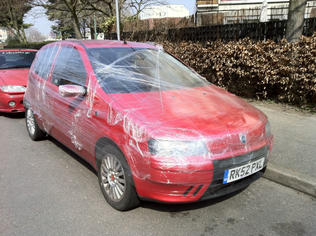 Who's the fool now?  Try getting into this vehicle in a hurry.  It's wrapped in plastic wrap.
