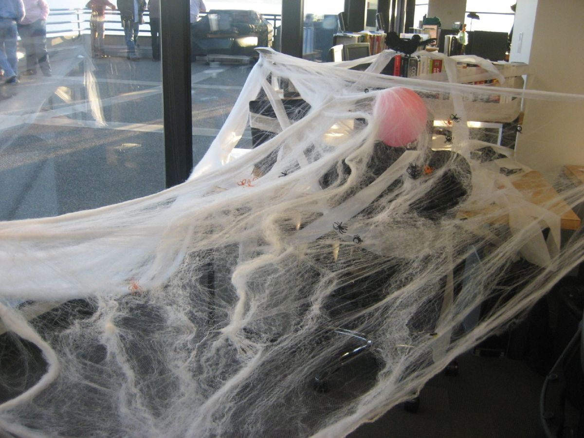 How about decorating a friend's cubicle with spider webs left over from Halloween decorations?
