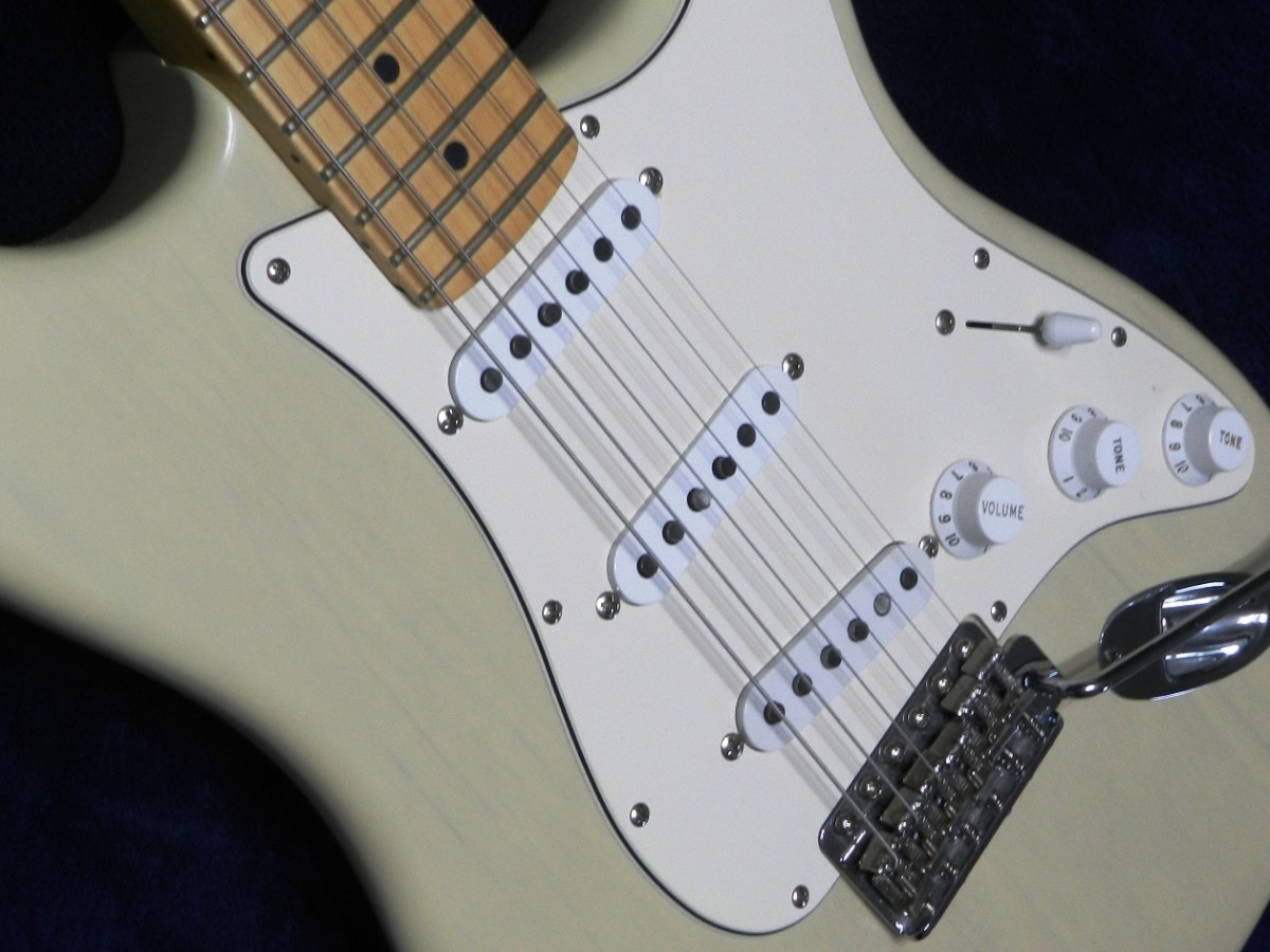 A Fender Stratocaster with three single-coil pickups.