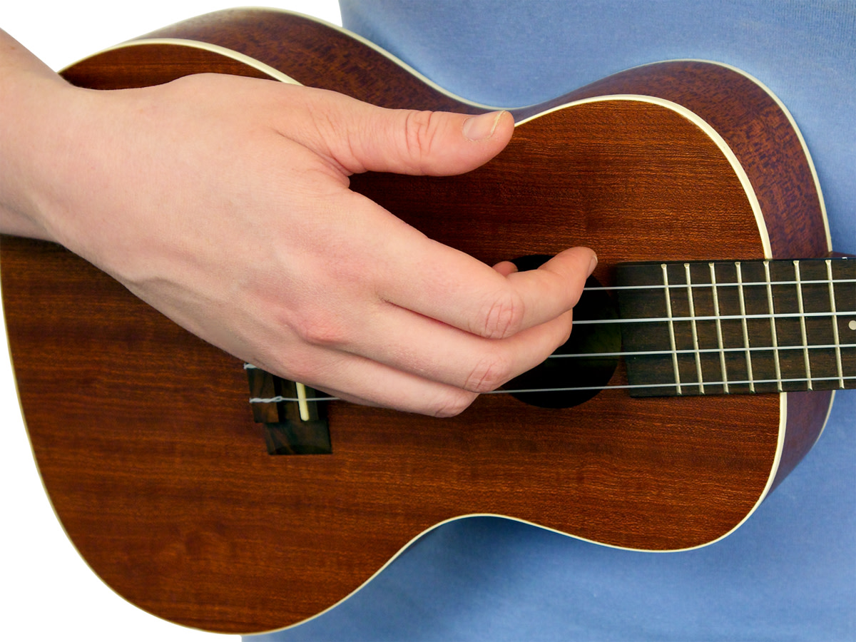 Example of the way your fingers should be when you bring them down across all 4 strings.