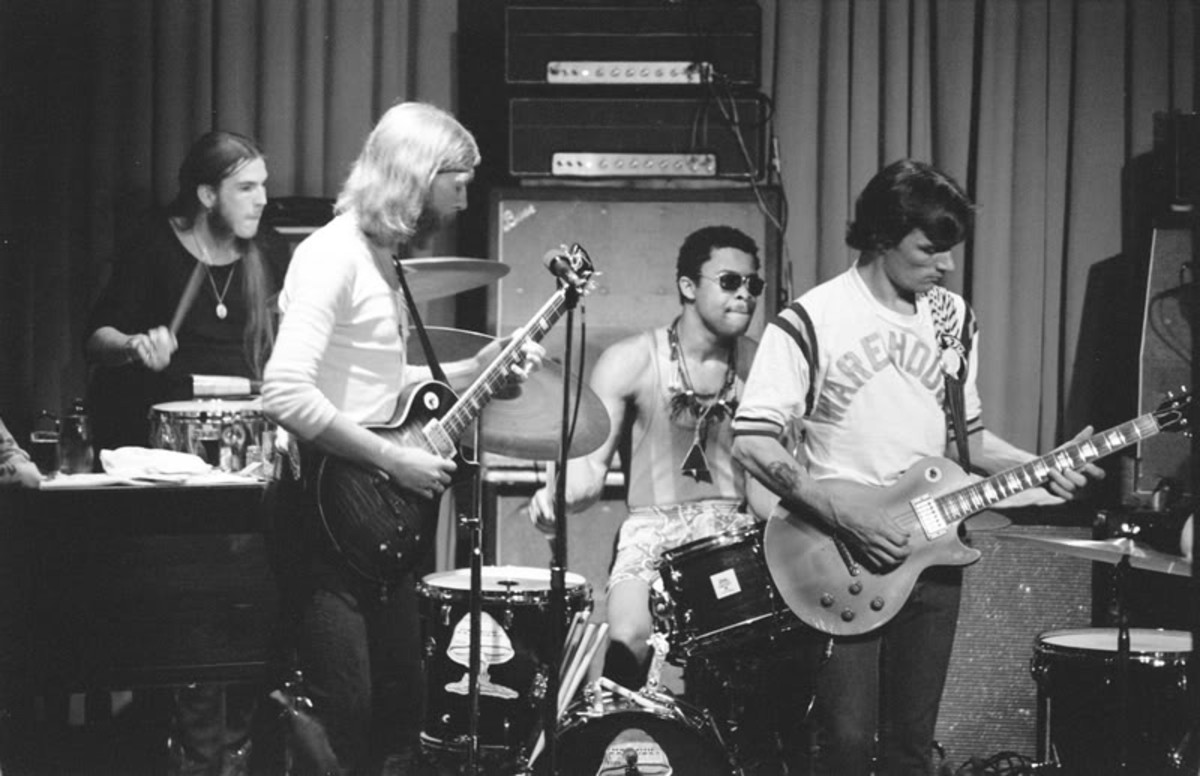 Butch Trucks, Duane Allman, Jaimoe, and Dickey Betts on stage with The Allman Brothers Band.