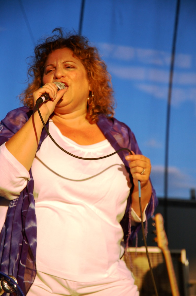 Singing in 90-degree heat can be a challenge to vocalists.