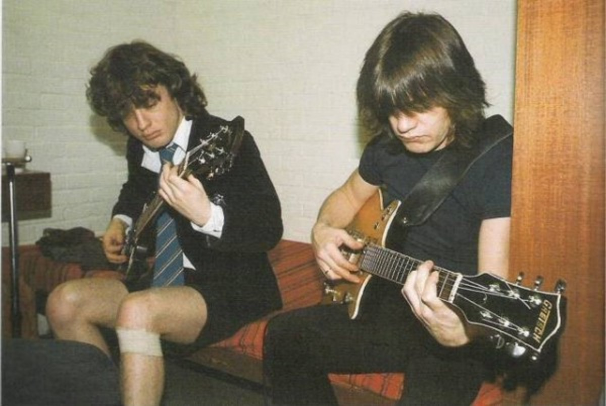 Brothers Angus and Malcolm Young.
