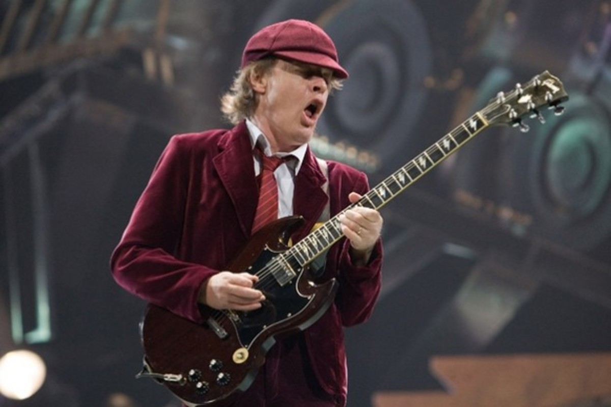 Angus Young with one of his custom made SGs, you can see this from the lightening bolt inlays on the fretboard.