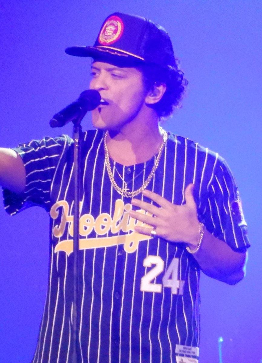 This is a photo of American entertainer Bruno Mars performing live during his 24K Magic World Tour