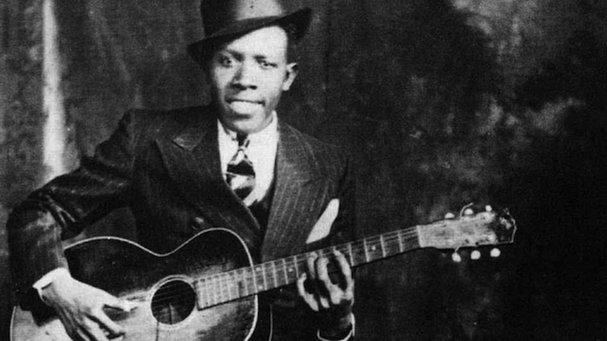 This is Robert Johnson and he is definitely holding the Gibson L-1 in this photo.