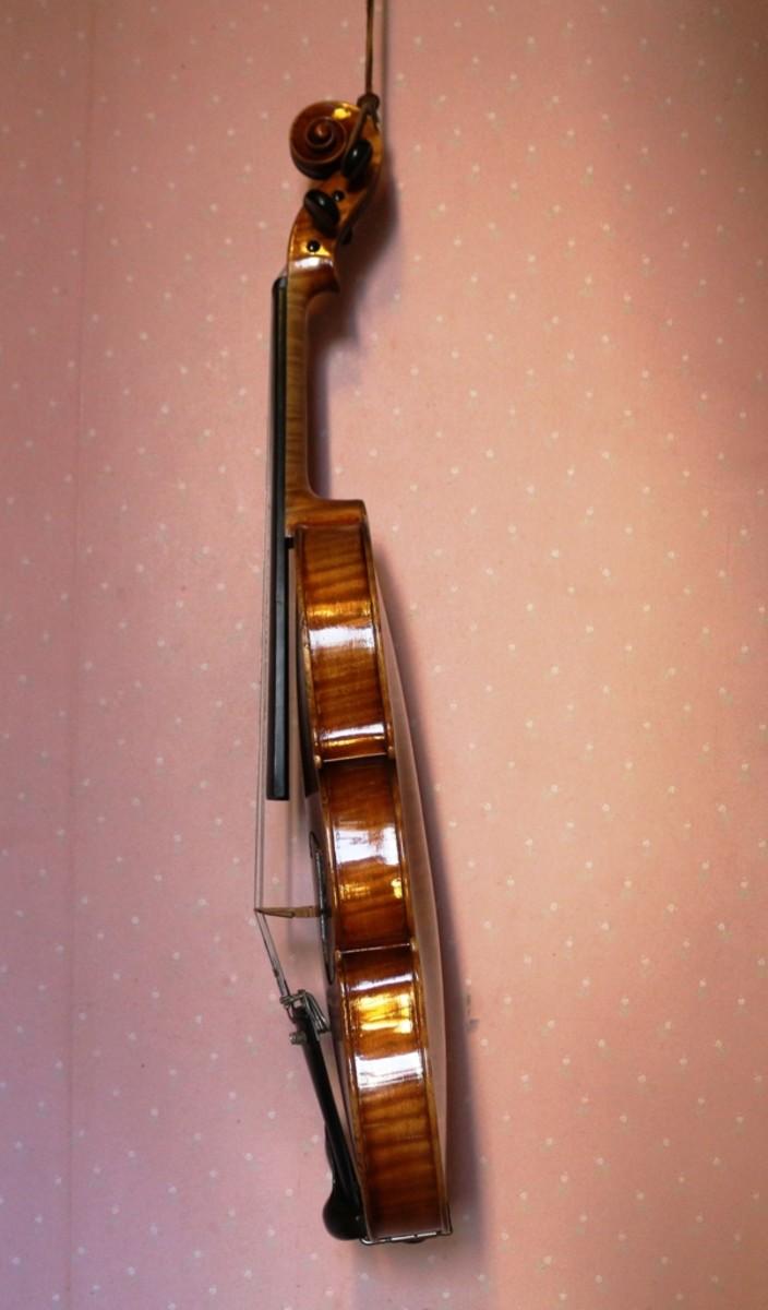Completed violin repair (side)