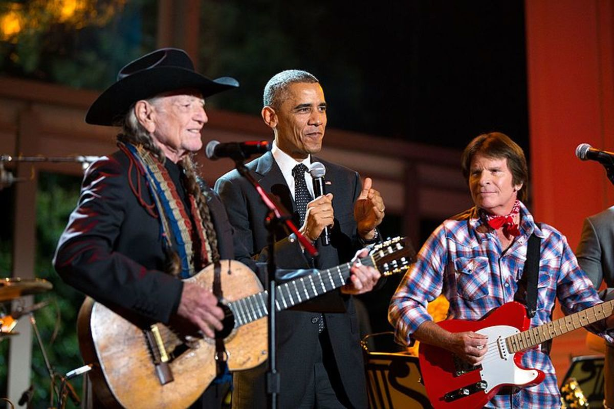 "President Barack Obama joins Willie Nelson and John Fogerty onstage at the conclusion of ""A Salute to the Troops: In Performance at the White House"" on the South Lawn of the White House, Nov. 6, 2014. (Official White House Photo by Pete Souza)"