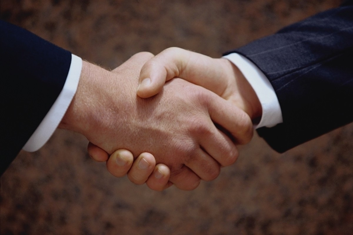 A firm handshake makes a good first impression on business colleagues.