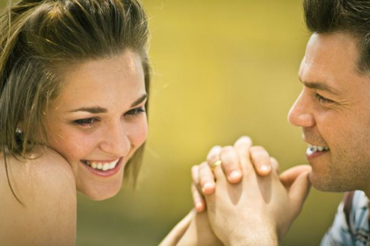 Guys love it when a girl laughs, smiles or blushes. Anything that gives him a clue she's noticed him!