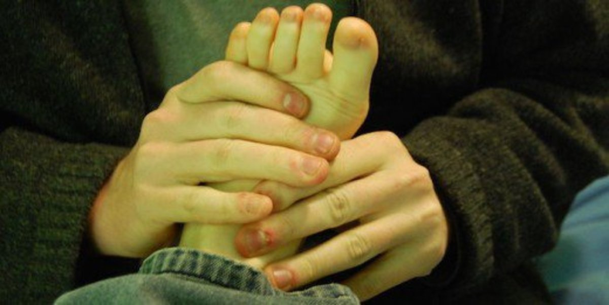 Give your girlfriend a foot massage to help her relax after a long day.
