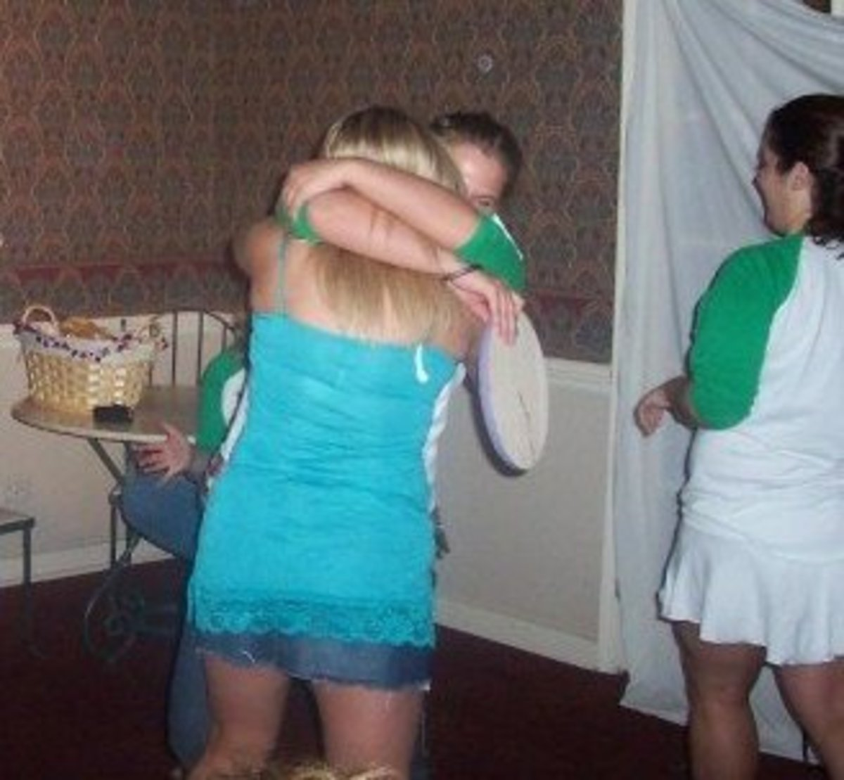 Two sorority sisters hugging