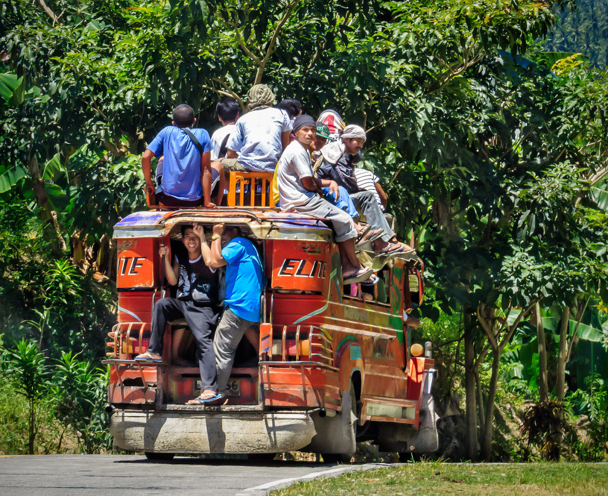 An overloaded jeepney in the Philippines.