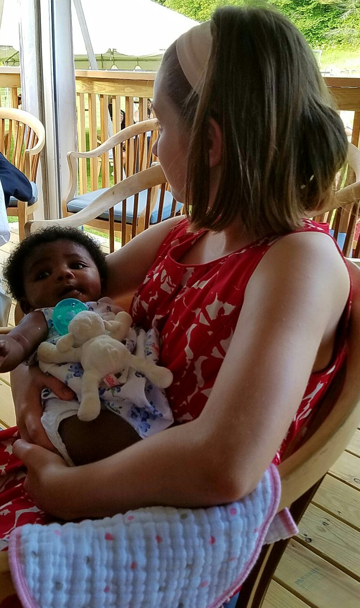 Babies feel most welcomed by the world through nurturing touch.  My daughter loved holding her new cousin at a recent family wedding. Weddings are great occasions for family reunions.