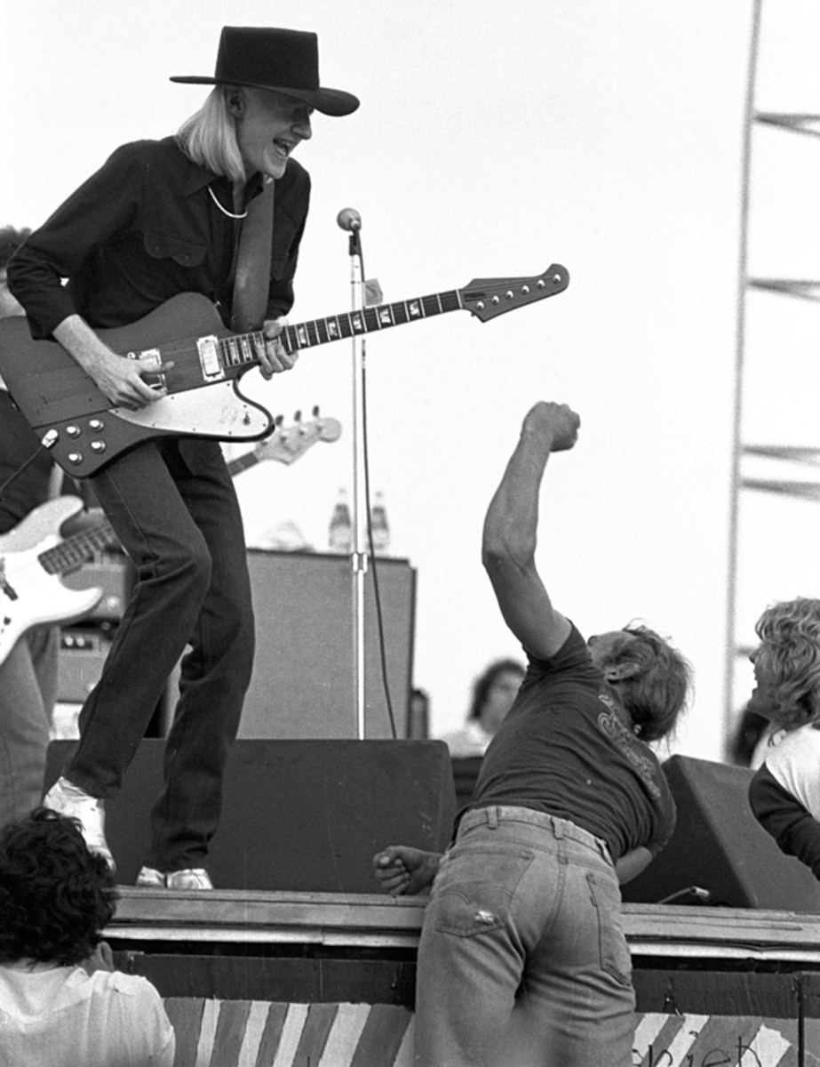 Johnny Winter (left) and fans