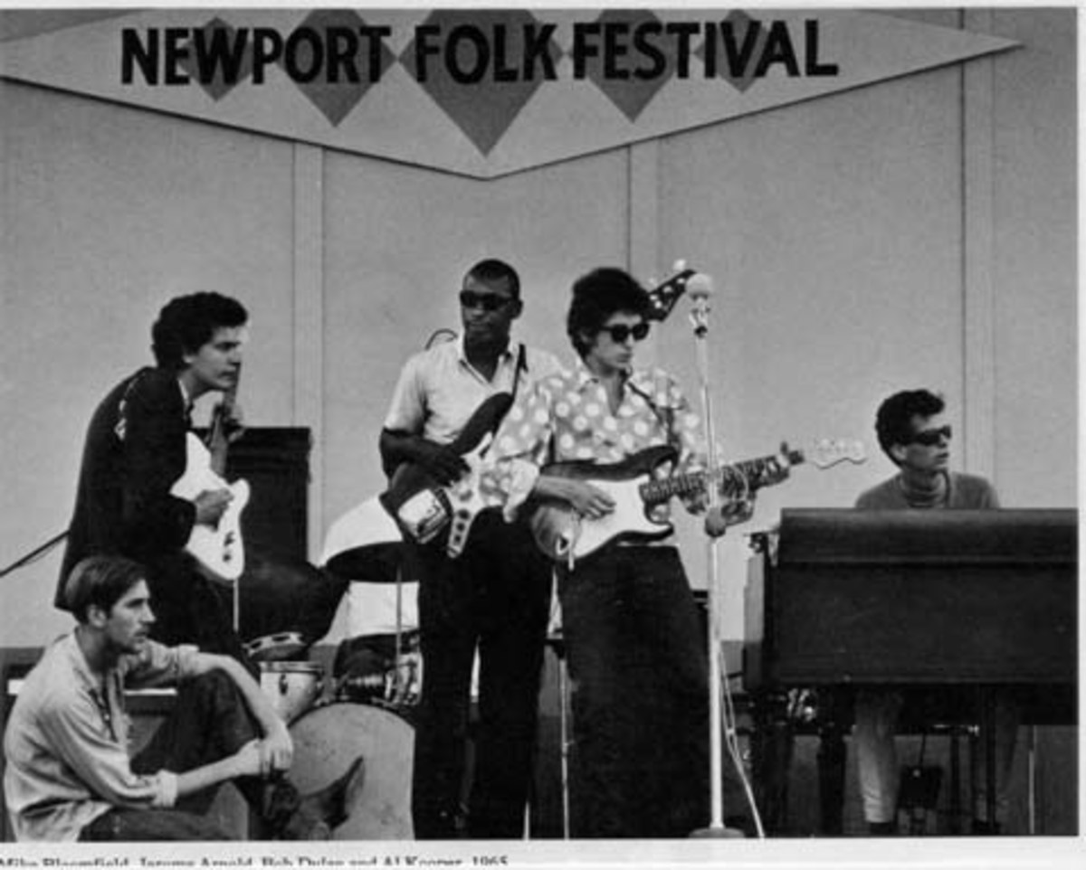 Bob Dylan and Mike Bloomfield (upper left) play at the Newport Folk Festival