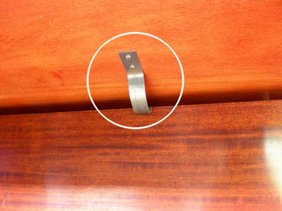 Push this metal bar upwards and gently pull the cover outwards.