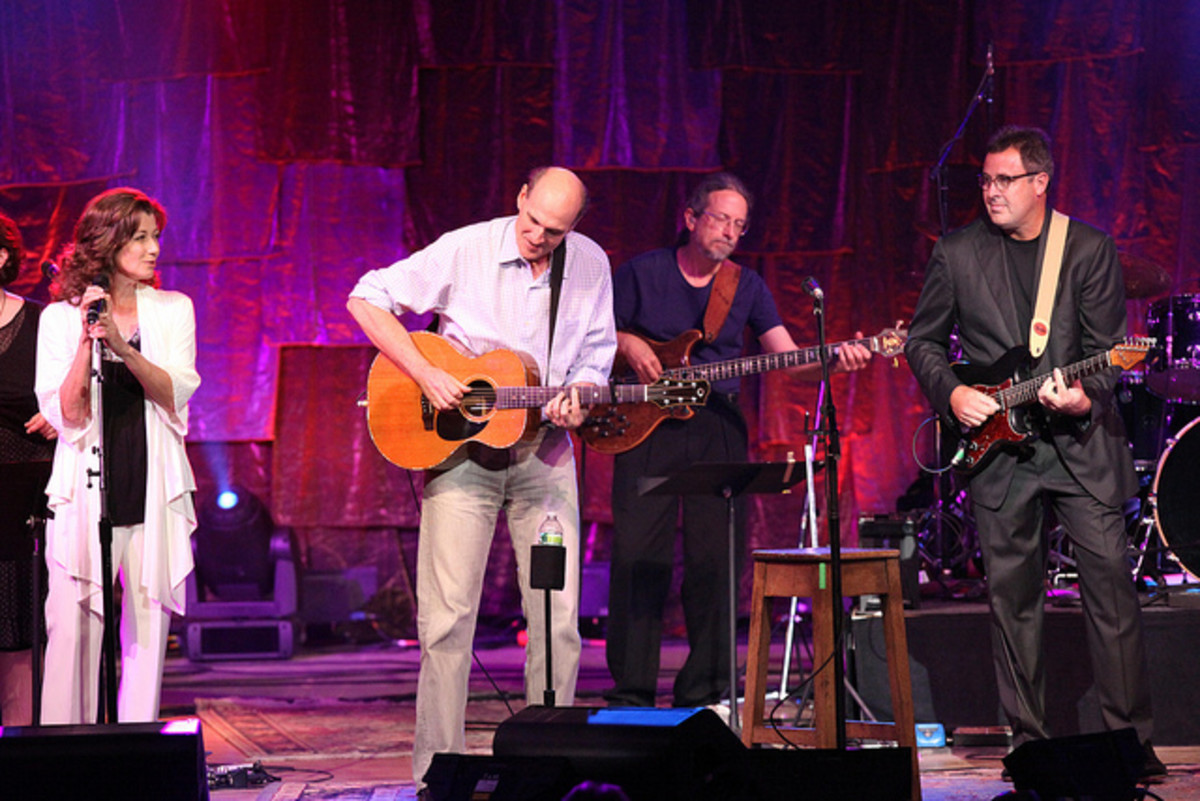 Amy Grant and Vince Gill with James Taylor perform at Tanglewood in Boston.