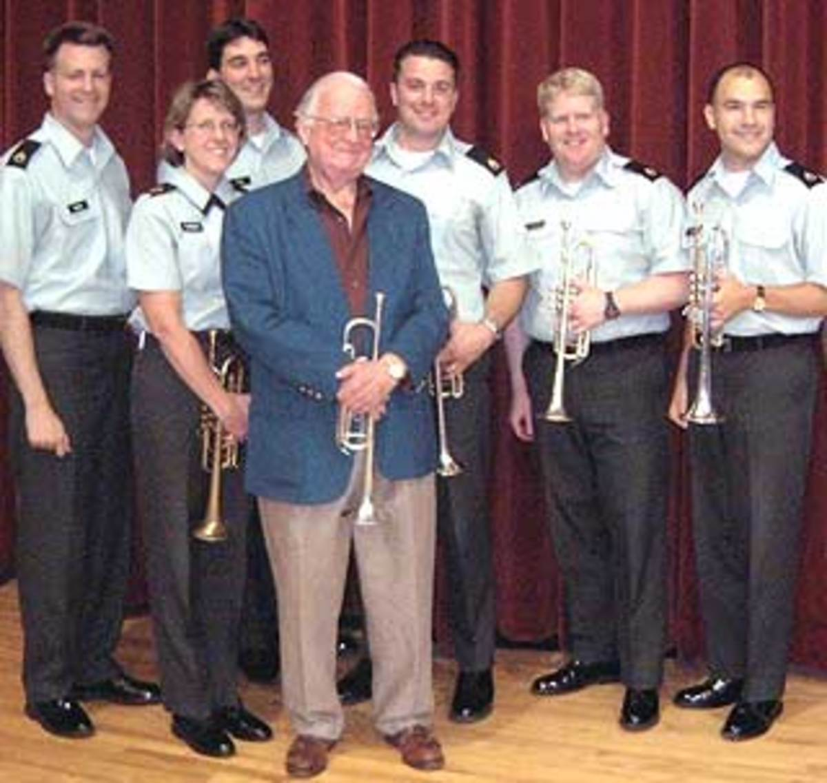Bud Herseth visiting the Army field band trumpets.  Courtesy International Trumpet Guild.
