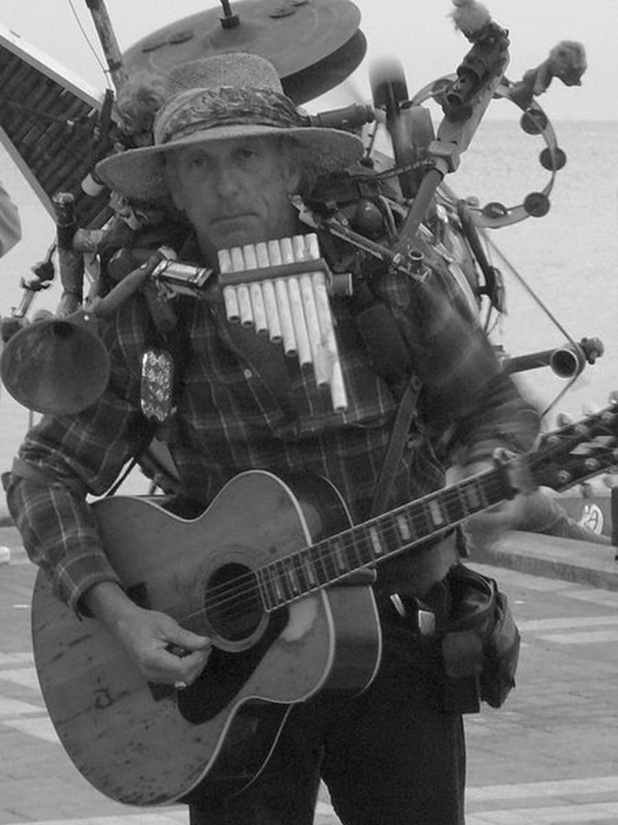 Key West street musician.  This guy really has to concentrate.  Image courtesy jster and Wikimedia Commons.