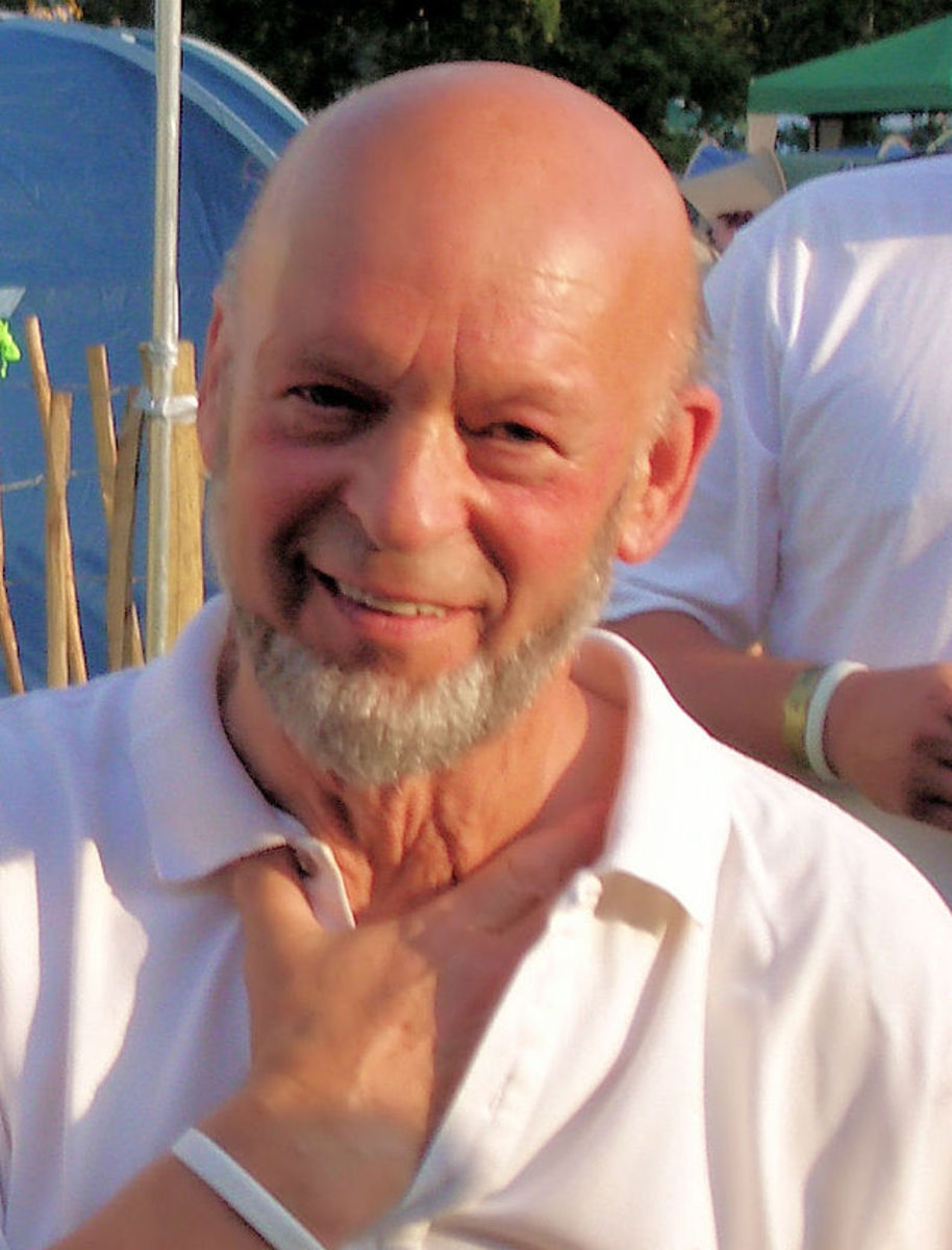Michael Eavis, founder and organiser of Glastonbury Festival.  When the festival is not happening, the land is used for livestock farming.