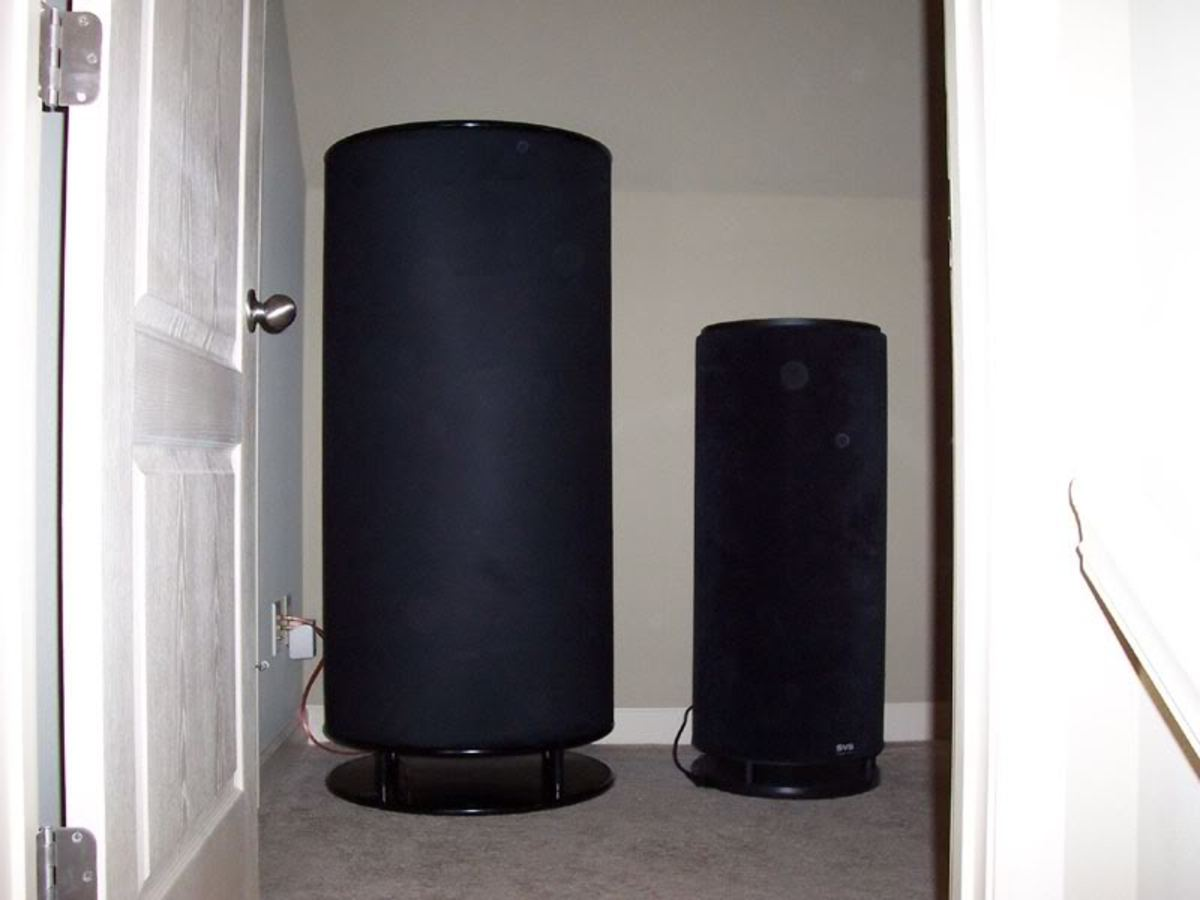 A DIY cylinder subwoofer on the left, next to a commercial sub.