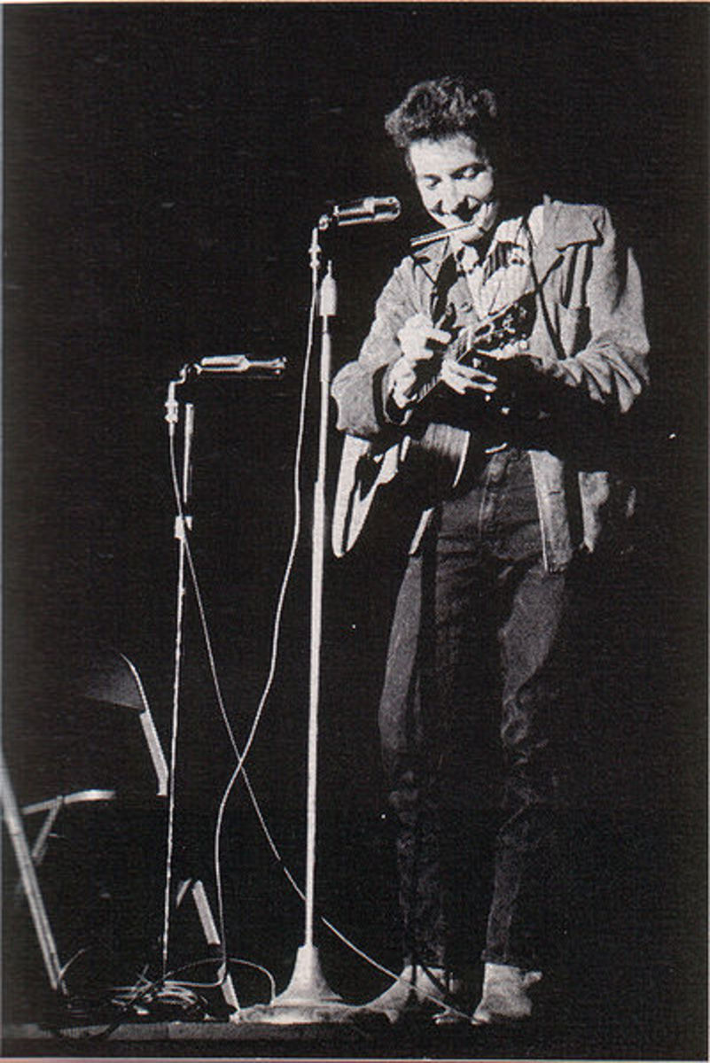 Bob Dylan performing at St. Lawrence University on November 26th, 1963. Dylan was a key figure in the protest movement.