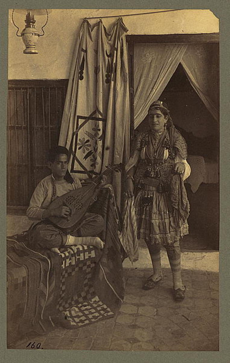 A young Armenian man seated, playing an oud. Published between 1860 and 1900.