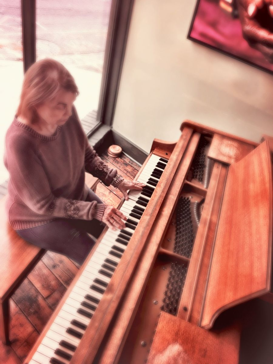 Author, Audrey Hunt, performing on an old baby grand piano. An older piano can still have a beautiful tone if it has been well-cared for.