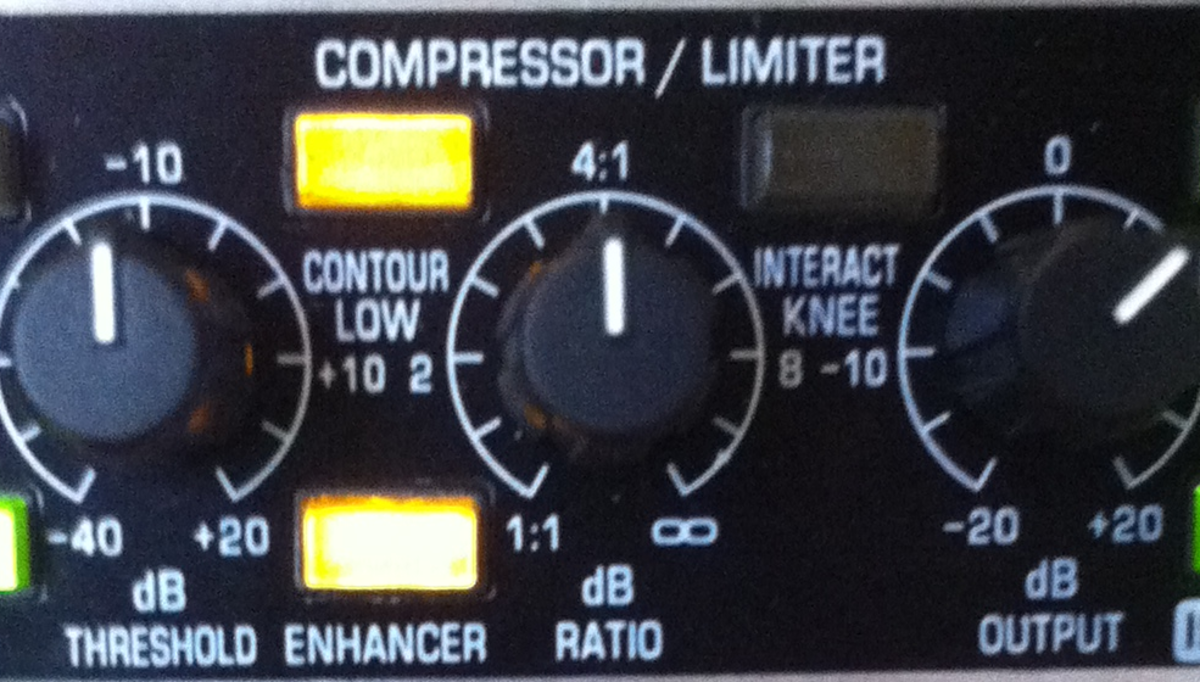 The compressor / limiter area. In this particular setup, the threshold is set to -10dB, the dB ration to 4:1 and the dB OUTPUT to about +5dB. The countour low and enhancer switches are on, while the interactive knee is off.