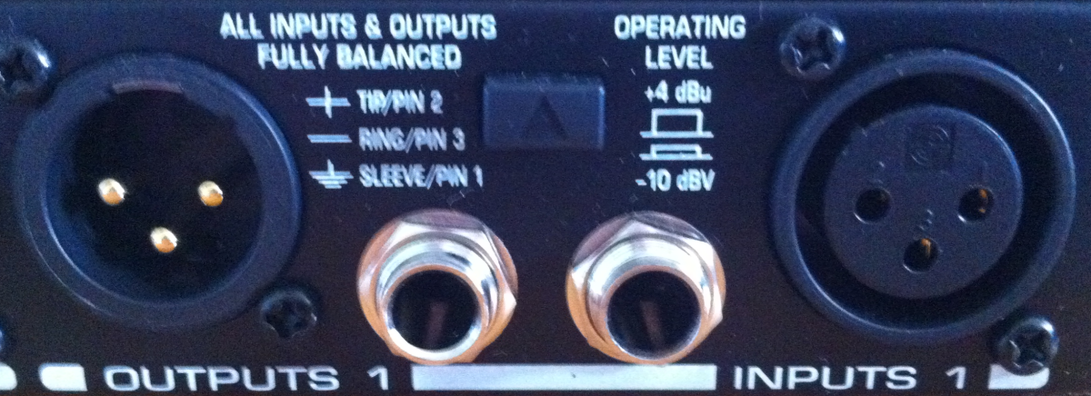 Inputs and outputs on channel 1, along with operating level switch.