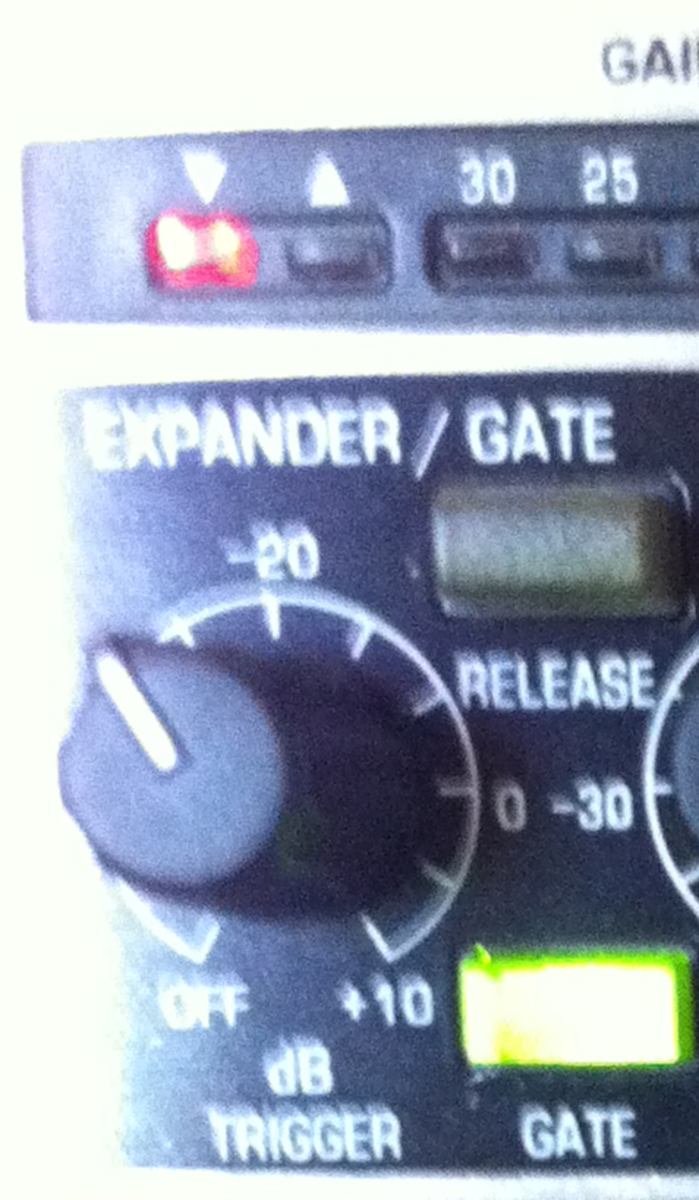 Close-up of expander / gate. With trigger set a little below -20dB, GATE switch (on), release switch (off). The red led with down-pointing arrow is lit because the signal coming in is below the threshold set by trigger.
